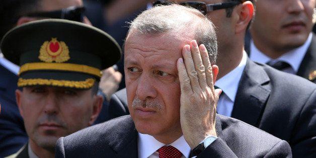 Turkey's President Recep Tayyip Erdogan  attends funeral prayers for Okan Tasan, a Turkish army officer killed in a Kurdish r