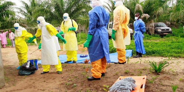 In this photo taken on Friday, June 19, 2015, the wrapped remains of a new born child suspected of contracting the Ebola viru