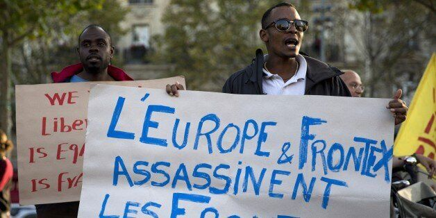 People shout slogans and hold placard reading 'Europe and Frontex assassinate, the borders kill' as part of a demonstration i