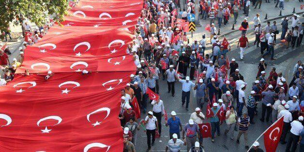 People wave the Turkish national flag as they demonstrate to condemn terrorism and attacks against Turkish security forces, i