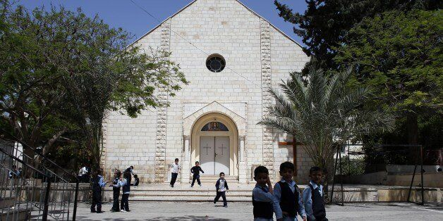 A picture taken on  May 3, 2014 shows Catholic and Muslim children playing in the yard of the Catholic school of Gaza City. C