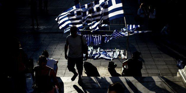 Greek flags stand for sale before the main pre-election rally of the Radical Left party SYRIZA in central Athens Syntagma squ
