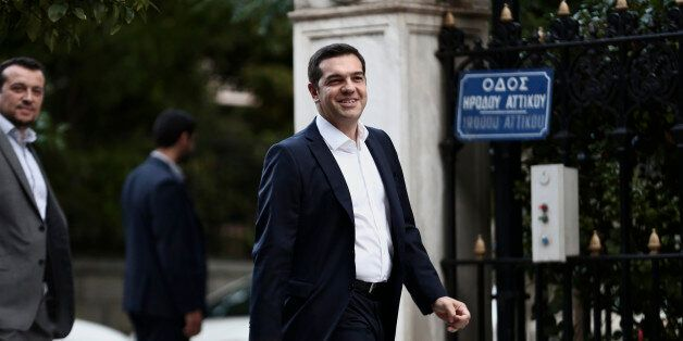 Alexis Tsipras, Greece's incoming prime minister and leader of the Syriza party, arrives at the presidential palace in Athens