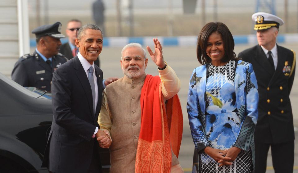 Breaking from protocol, Narendra Modi greeted U.S. President Barack Obama at the Palam Air Force Station on Sunday morning. D