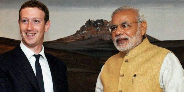 Indian Prime Minister Narendra Modi, right, shakes hands with Facebook CEO Mark Zuckerberg during a meeting in New Delhi, Ind