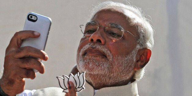 FILE- In this April 30, 2014 file photo, India's main opposition Bharatiya Janata Party's prime ministerial candidate Narendr