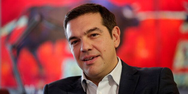 Left-wing Syriza party leader Alexis Tsipras speaks with leader of the right-wing Independent Greeks party Panos Kammenos dur