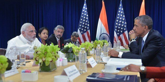 India's Prime Minister Narendra Modi(L) speaks during a bilateral meeting with US President Barack Obama (R) at the United Na