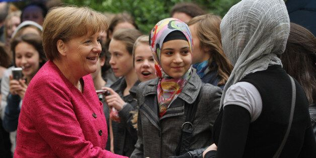 BERLIN, GERMANY - MAY 16:  German Chancellor Angela Merkel greets students at the Sophie Scholl school during a visit on the