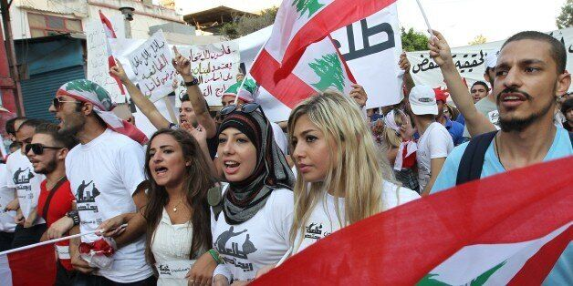 Lebanese protesters wave national flags during a demonstration denouncing Lebanon's stagnant political system, that has becom