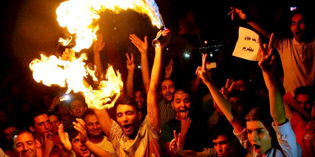 Iranians celebrate following a landmark nuclear deal in Tehran, Iran, Tuesday, July 14, 2015. Overcoming decades of hostility