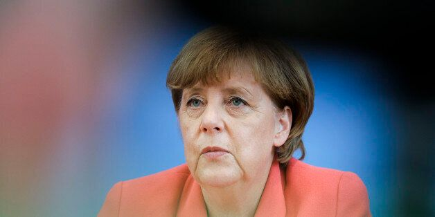 German Chancellor Angela Merkel attends her annual summer news conference in Berlin, Monday, Aug. 31, 2015. (AP Photo/Gero Br