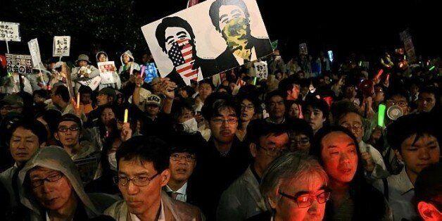 TOKYO, JAPAN - SEPTEMBER 17:  People protest against the new Japan Security Bill on September 17, 2015 in Tokyo, Japan. Hundr