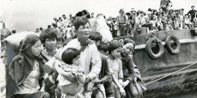 VUNG TAU , VIETNAM - APRIL,1975: Refugees from Da Nang and Hue, north of Saigon, pour ashore from navy barges at Vung Tau, so