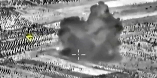 This image made from footage taken from Russian Defense Ministry official website on Friday, Oct. 2, 2015, shows another atta