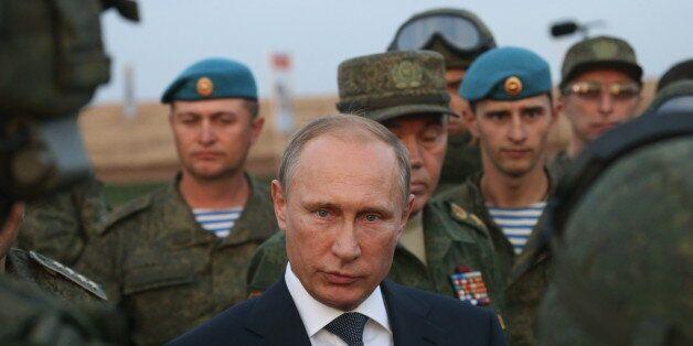 ORENBURG, RUSSIA- SEPTEMBER 19: Russian President Vladimir Putin talks to officers as he is visiting the Center -2015 Militar
