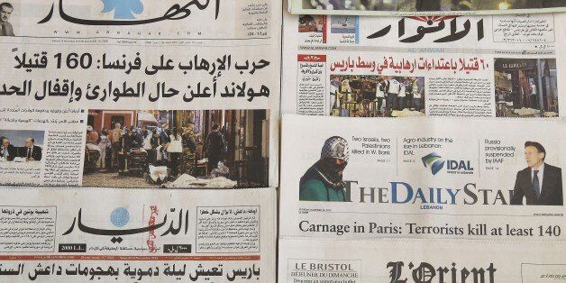 A photo taken on November 14, 2015 in the Lebanese capital Beirut shows newspapers bearing the headlines of the deadly Paris