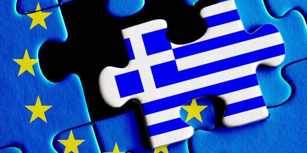 European Union crisis and Greece debt concept. Greek flag on missing puzzle.