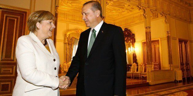 ISTANBUL, TURKEY - OCTOBER 18: German Chancellor Angela Merkel (L) shakes hands with Turkey's President Recep Tayyip Erdogan