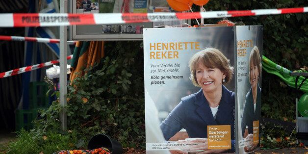 Election posters of independent candidate for the mayor of Cologne Henriette Reker stand behind a police barrier in Cologne,