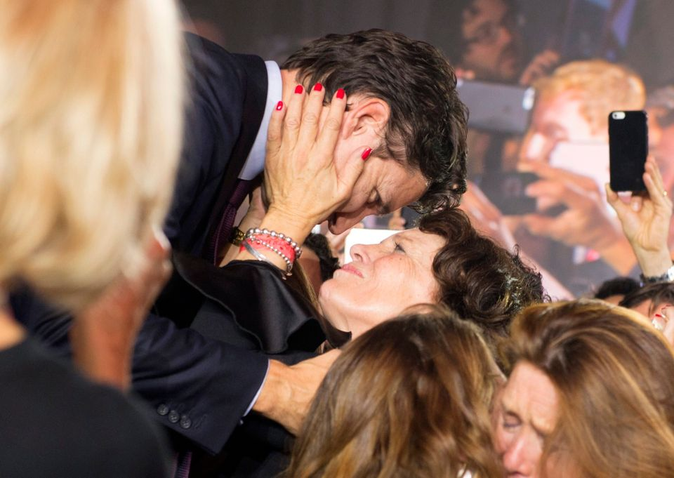 Liberal leader and incoming prime minister Justin Trudeau hugs his mother Margaret Trudeau as he makes his way on stage at Li