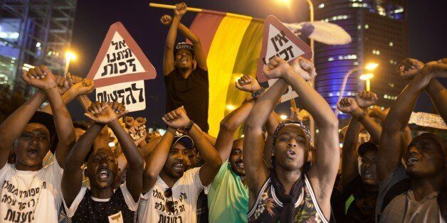 Hundreds of Ethiopian Israelis protestors demonstrate against police brutality and racism, as the protestors try to block a m