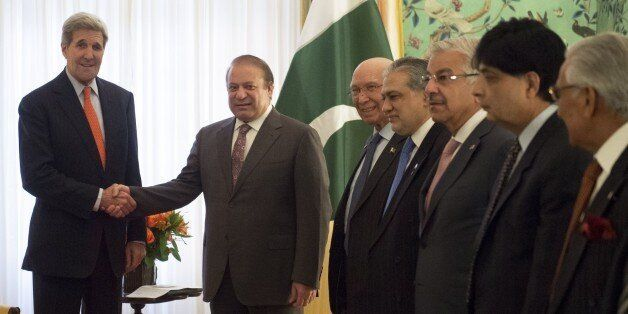 US Secretary of State John Kerry(L) shakes hands with Pakistani Prime Minister Nawaz Sharif prior to meetings at Blair House