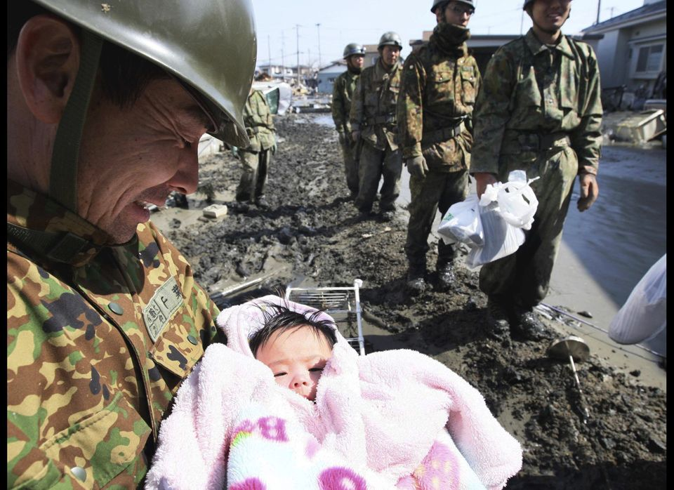 A four-month-old girl who had been swept from her parents' arms in the shattered village of Ishinomaki when the deadly wave c