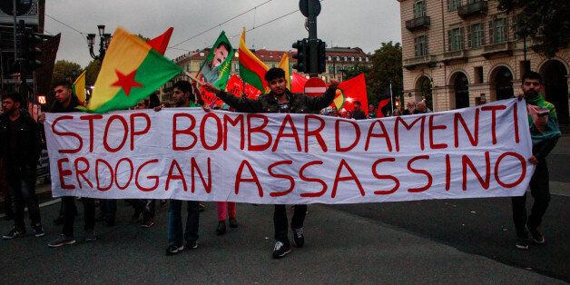 ITALY, TURIN, EUROPE - 2015/10/13: Demonstrators wave flags and bring placards against the Turkish President Erdogan and the