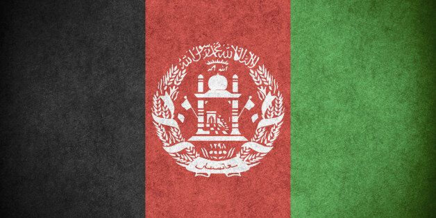 flag of Afghanistan or Afghan banner on paper rough pattern texture