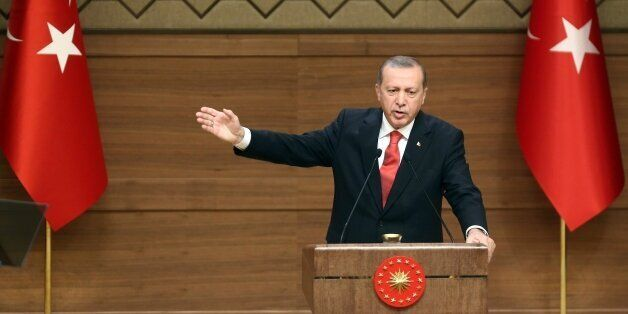 Turkish President Recep Tayyip Erdogan delivers a speech during a meeting with village chiefs at the Presidential Palace in A