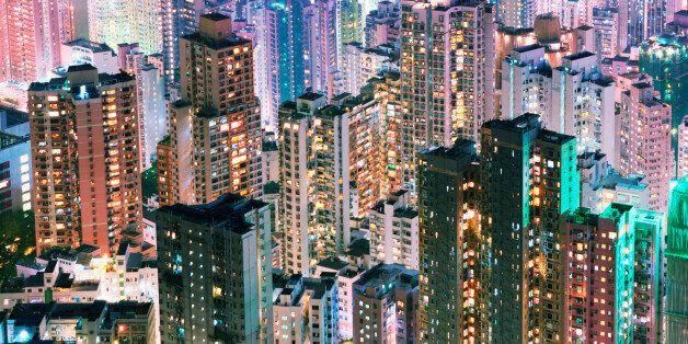 China, Hong Kong, apartment blocks, at night, elevated view.