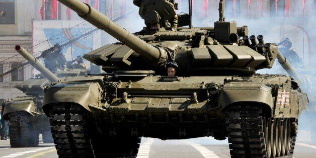 Russian tanks parade on Dvortsovaya (Palace) Square in St.Petersburg during the Victory Day ceremony at on May 9, 2015. Russi