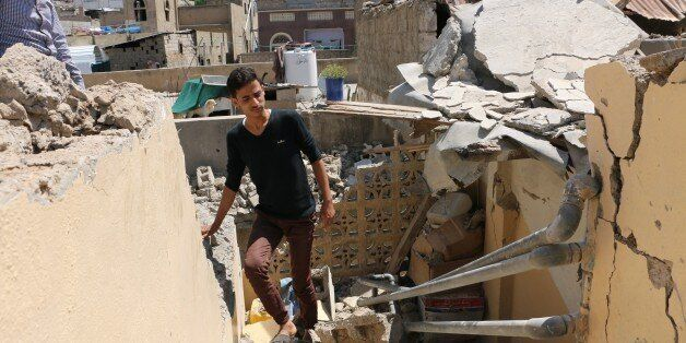 TAIZ, YEMEN - OCTOBER 22: Yemenis inspect destroyed buildings after Houthis attacked on residential areas with Katyusha rocke