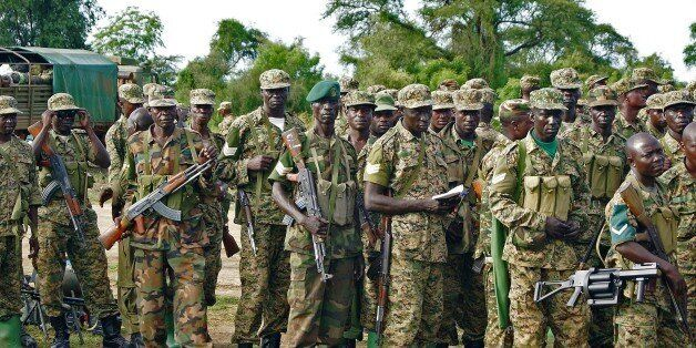 Uganda People's Defence Force (UPDF) troops assemble amongst their vehicles in Bor on October 20, 2015. The South Sudanese mi