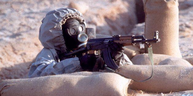 Syrian soldier wearing biohazard gear