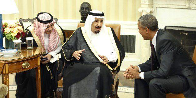 King Salman bin Abd alAziz of Saudi Arabia (C) speaks with US President Barack Obama during their meeting in the Oval Office