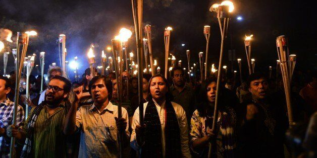 Bangladeshi activists take part in a torch-lit protest in Dhaka on November 2, 2015 against the killing of secular publisher