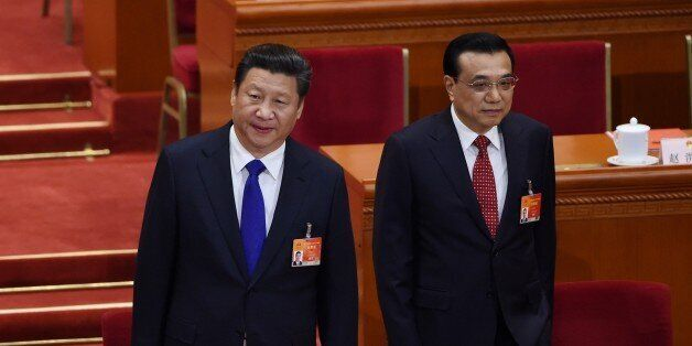 Chinese President Xi Jinping (L) and Premier Li Keqiang (R) arrive for the closing of the 3rd Session of the 12th National Pe
