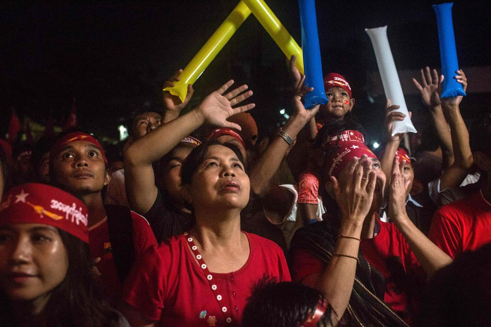YANGON, MYANMAR - NOVEMBER 09:  Crowds gather for the election result announcement in front of the National League for Democr
