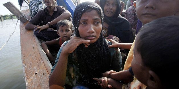 Rescued migrants weep upon arrival Simpang Tiga, Aceh province, Indonesia, Wednesday, May 20, 2015. Hundreds of migrants stra