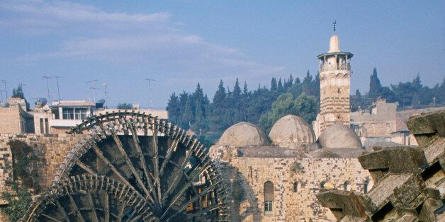 Syria, Central, Hama, Wooden norias or waterwheels on the Orontes river and the Al-Nuri Mosque dating from 1172 and built of