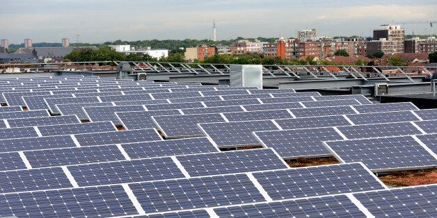 A picture shows solar panels installed on the roof of a building in Lille on September 9, 2013. AFP PHOTO/PHILIPPE HUGUEN