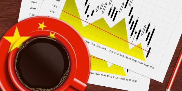 coffee with chinese flag and stock exchange chart lying on wooden desk