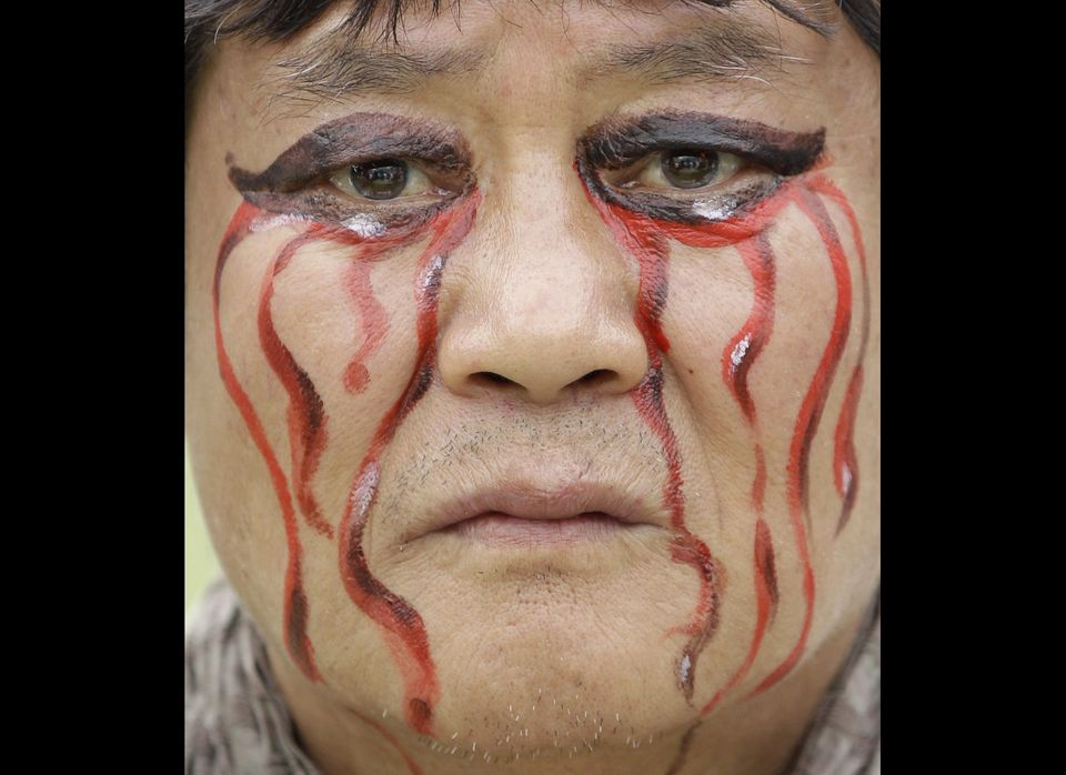 A worker has his face painted participates in a May Day rally in downtown Seoul, South Korea, Sunday, May 1, 2011. Tens of th
