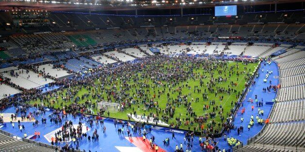 Spectators invade the pitch of the Stade de France stadium after the international friendly soccer France against Germany, Fr