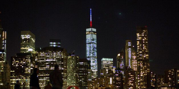 The One World Trade Center spire is lit blue, white and red after New York Gov. Andrew Cuomo announced the lighting in honor
