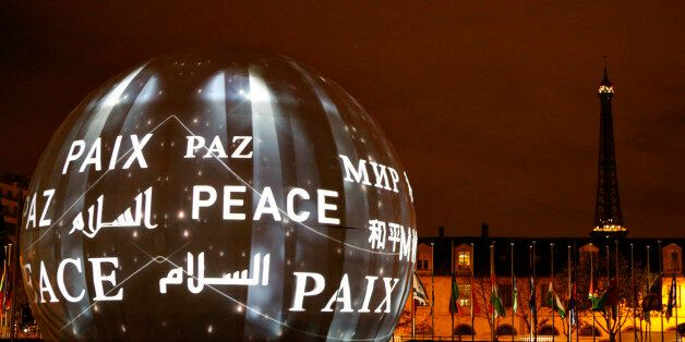 The word peace in the six official languages of the organization is projected at UNESCO headquarters in Paris, France, Saturd