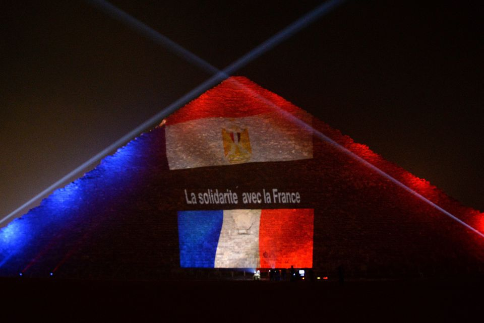 GIZA, EGYPT - NOVEMBER 15: The Great Pyramid (C) is illuminated in the colours of the French flag in order to show solidarity