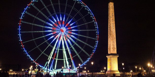 PARIS, FRANCE - NOVEMBER 16:  The Roue de Paris is illuminated in Red, White and Blue in honor of the victims of Friday's ter
